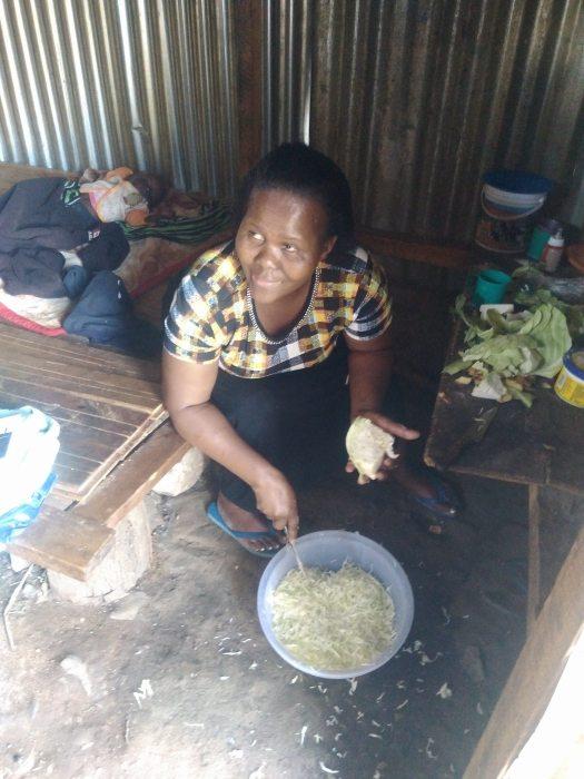 Director Lillian making Chapati