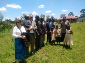 Sherry, Thom and Kitale Leaders praying for future land